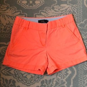"""Orange J. Crew chino shorts with 3"""" inseam"""
